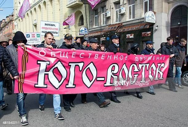 ProRussian activists rally in Kharkiv downtown on March 30 2014 US Secretary of State John Kerry met his Russian counterpart today in Paris France...