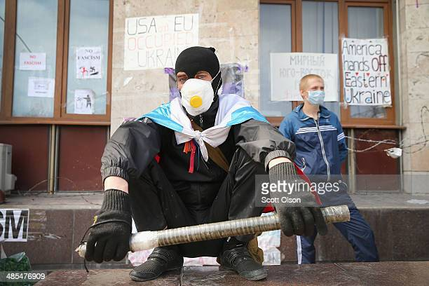 Pro-Russian activists stand guard in front of the Donetsk Regional Administration building on April 18, 2014 in Donetsk, Ukraine. The group of...