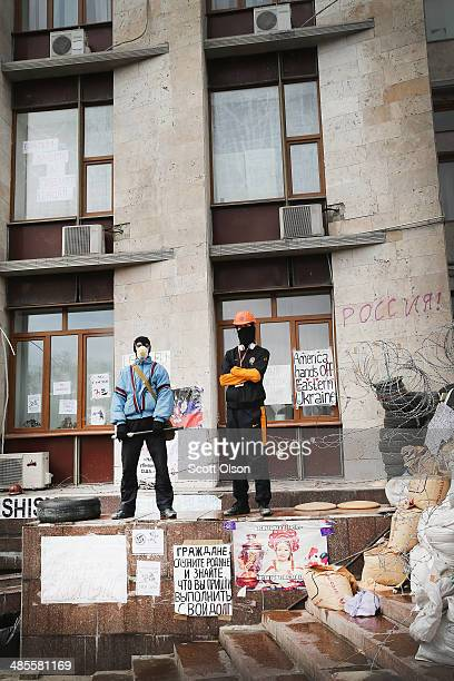 Pro-Russian activists stand guard outside of the Donetsk Regional Administration building on April 19, 2014 in Donetsk, Ukraine. The group of...