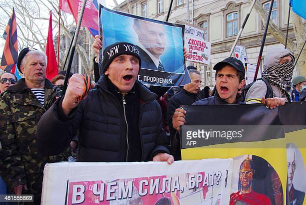 ProRussian activists take part in a rally in Odessa on March 30 2014 US Secretary of State John Kerry met his Russian counterpart today hoping to...