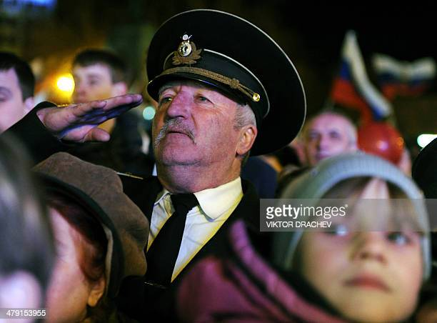 ProRussian Crimeans celebrate in Sevastopol on March 16 2014 after partial showed that about 955 percent of voters in Ukraine's Crimea region...
