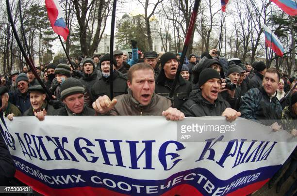 Prorussian demonstrators demonstrate in front of the Crimean parliament building in Simferopol on February 27 2014 Ukraine's ousted proMoscow...