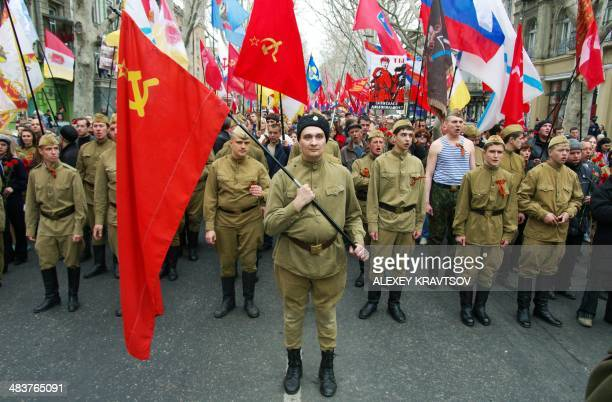 Pro-Russian demonstrators dressed in Soviet military uniforms shout slogans as they take part in a rally in the southern Ukrainian city of Odessa on...