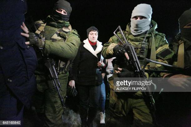 TOPSHOT ProRussian fighters convoy member of Ukrainian Parliament and former military pilot Nadiya Savchenko freed from a Russian jail on May 2016...
