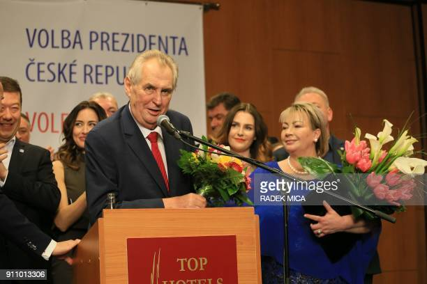 ProRussian incumbent Milos Zeman gives a speech next to his wife Ivana as he celebrates his victory with his staff members after he was reelected...