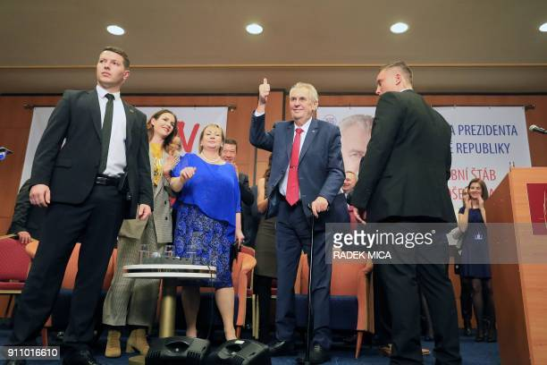 ProRussian incumbent Milos Zeman gives a thumb up as he celebrates his victory with his staff members after he was reelected Czech President on...