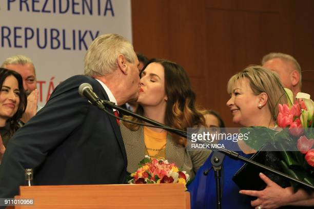 ProRussian incumbent Milos Zeman kisses his daughter Katerina as he celebrates his victory with his staff members after he was reelected Czech...