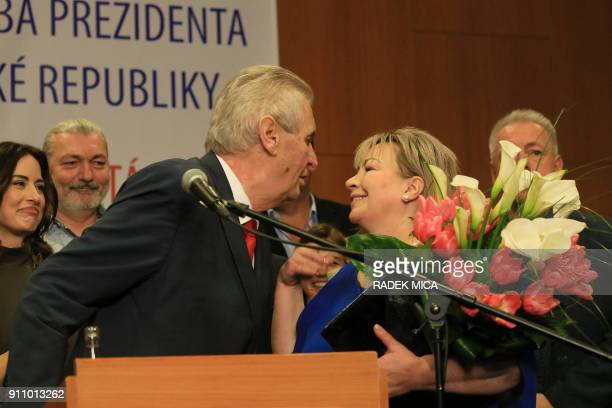 ProRussian incumbent Milos Zeman kisses his wife Ivana as he celebrates his victory with his staff members after he was reelected Czech President on...