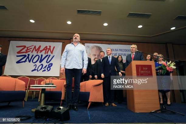 ProRussian incumbent Milos Zeman listens to pop singer Daniel Hulka singing the national anthem as he celebrates his victory with his staff members...