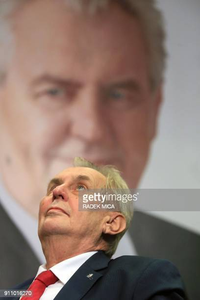ProRussian incumbent Milos Zeman looks up as he celebrates his victory with his staff members after he was reelected Czech President on January 27...