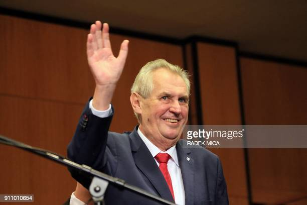 ProRussian incumbent Milos Zeman waves as he arrives to celebrate his victory with his staff members after he was reelected Czech President on...