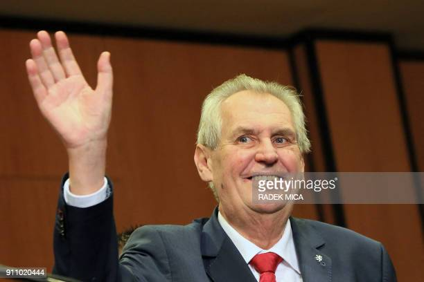 ProRussian incumbent Milos Zeman waves to the audience as he celebrates his victory with his staff members after he was reelected Czech President on...