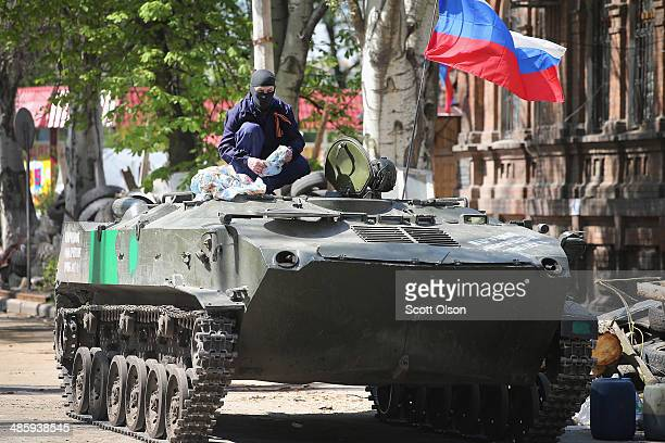 Pro-Russian militant sits on top of an armored personnel carrier in front of the occupied Ukraine Security Service building on April 21, 2014 in...