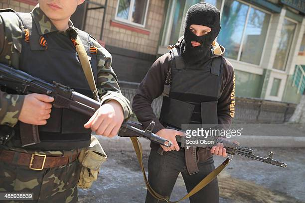 Pro-Russian militant stand guard in front of the occupied Ukraine Security Service building on April 21, 2014 in Slovyansk, Ukraine. Pro-Russian...