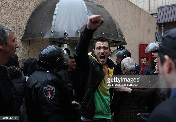 Pro-Russian militant , who was arrested along with other militants during a Ukrainian unity rally on May 2, reacts after being freed by police...