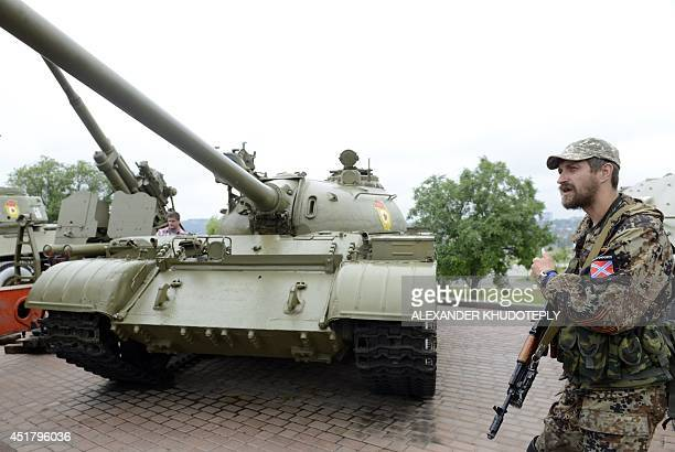 ProRussian militants prepare to take a T54 Sovietera medium tank and an artillery gun from the WWII openair museum in the eastern Ukrainian city of...