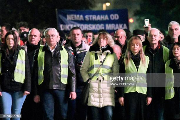 ProRussian Montenegro's government opposition supporters wear yellow vests during a demonstration in Podgorica on December 9 to protest against the...