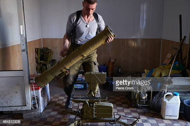 A proRussian rebel assembles a antitank rocket launcher on the southern front non February 24 2015 near Mariupol Ukraine Fighting has eased in recent...