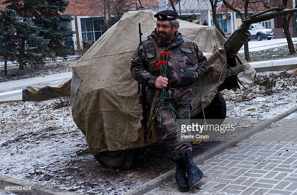 A proRussian rebel attends the funerals of four rebel fighters on February 16 2015 in Donetsk Ukraine The rebels died on the frontline in Lohvynove...