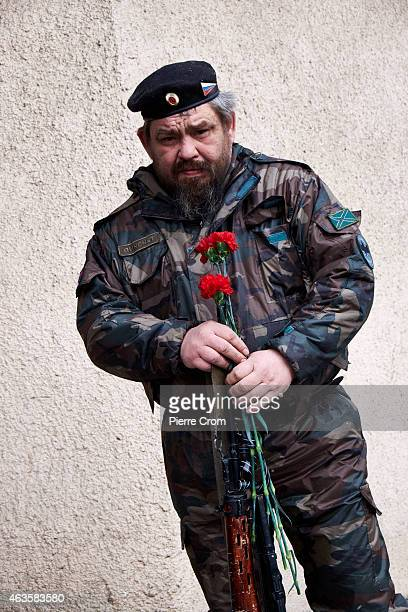 ProRussian rebel attends the funerals of four rebel fighters on February 16 2015 in Donetsk Ukraine The rebels died on the frontline in Lohvynove...