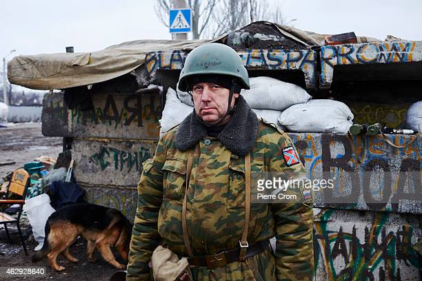 ProRussian rebel Ladomir stands guard on a road blockon February 7 2015 in Uglegorsk Ukraine According to ProRussian rebels control of Uglegorsk on...