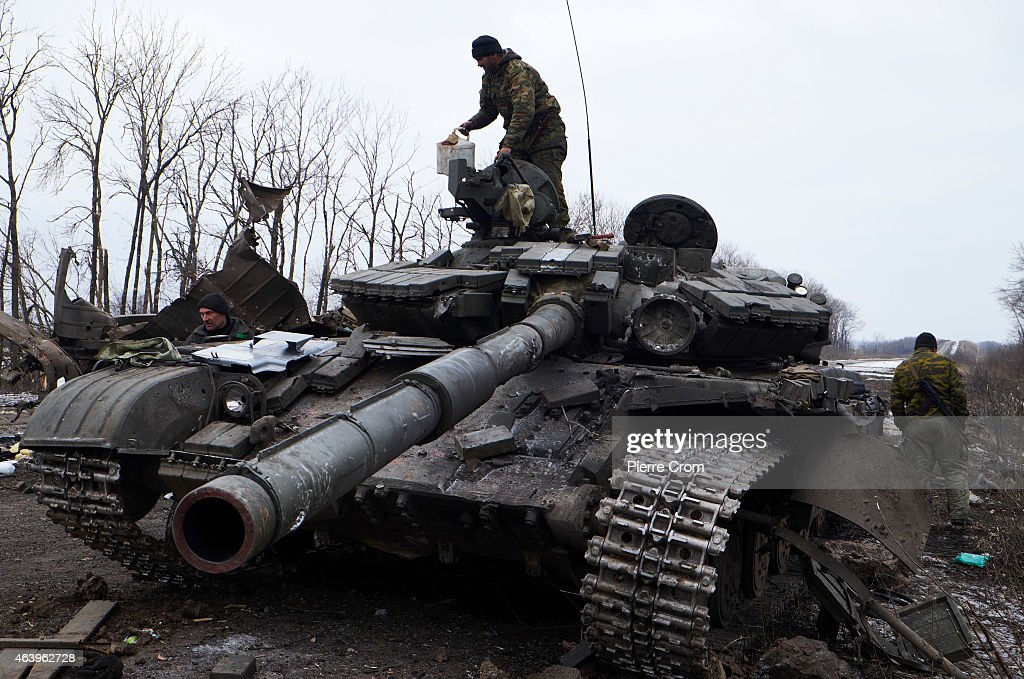 A pro-Russian rebel stands atop a Ukrainian tank on the outskirt of the town on February 20, 2015 in Debltseve, Ukraine. The strategic railway town of Debaltseve is of under the control of pro-Russian rebel fighters, after Ukrainian Government forces began to withdraw from the town early on Wednesday, after heavy fighting.