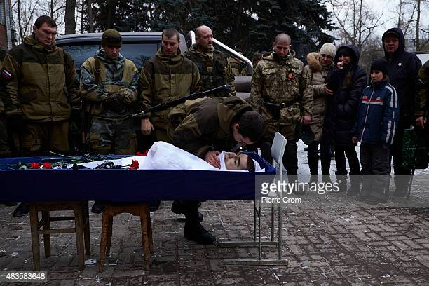 ProRussian rebels and relatives attend the funerals of four rebel fighters on February 16 2015 in Donetsk Ukraine The rebels died on the frontline in...
