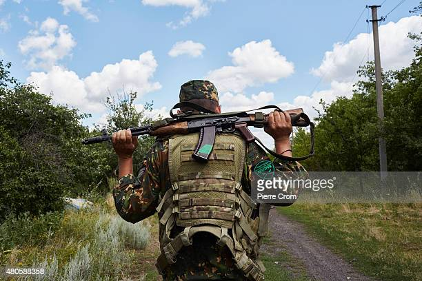 ProRussian rebels fighters of the Prezrak batallion fighting on the side of selfproclaimed Lugansk People's Republic hold their positions on the...