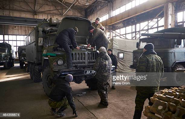 ProRussian rebels of the Separate Repair and Refurbishment Battalion repair seized Ukrainian military vehicles and artillery in a factory compound on...