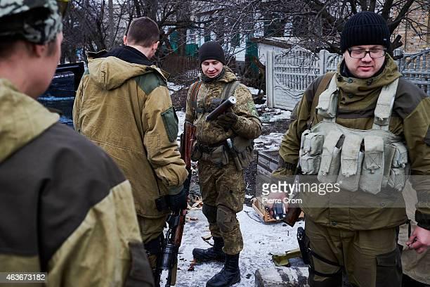 Pro-Russian rebels outside their base in an area damaged by artillery fire on February 5, 2015 in Nikishyne near Debaltseve, Ukraine. Nikishyne is...