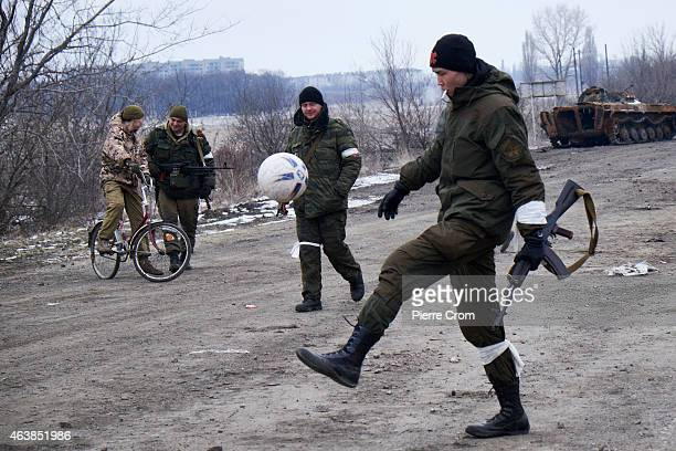 ProRussian rebels play with a football on the road to Debaltseve on February 19 2015 in Vuglegirsk near Debaltseve Ukraine According to reports...