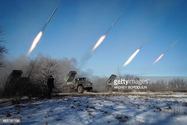 ProRussian rebels stationed in the eastern Ukrainian city of Gorlivka Donetsk region launch rockets from Grad launch vehicles on February 18 2015...