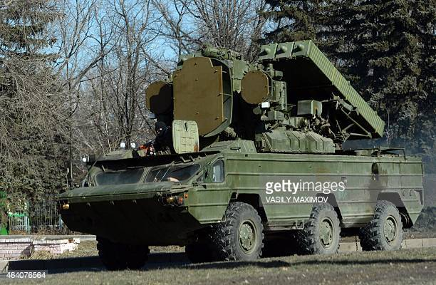 ProRussian separatist ride on the 9K33 Osa surfacetoair missile system in the eastern Ukrainian city of Makeyevka on February 21 2015 Ukraine's...