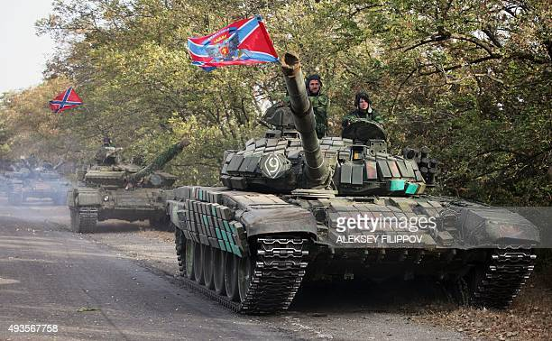 ProRussian separatist soldiers withdraw their tanks from position near town of Novoazovsk in Donetsk region on October 21 2015 Ukrainian forces and...