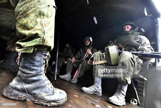 Pro-Russian separatists go to the front armed on February 9, 2015 in Uglegorsk, 6 kms southwest of Debaltseve. The European Union on February 9 put...