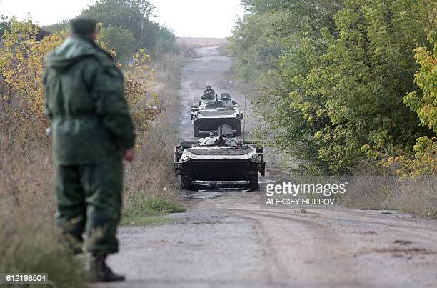 ProRussian separatists troops leave their position during withdrawal in the village of Petrovske some 50 km from Donetsk on October 3 2016 Ukraine's...