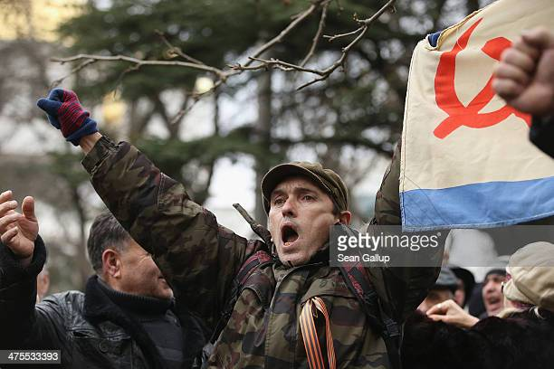 Pro-Russian supporters rally outside the Crimean parliament building on February 28, 2014 in Simferopol, Ukraine. According to media reports Russian...