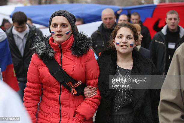 Pro-Russian sympathizers display the colours of the Russian flag as they march in the city center on March 1, 2014 in Simferopol, Ukraine. Earlier in...