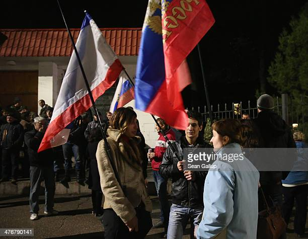 ProRussian sympathizers holding Russian flags stand outside the Ukrainian naval headquarters following an incident in which UN envoy Robert Serry was...