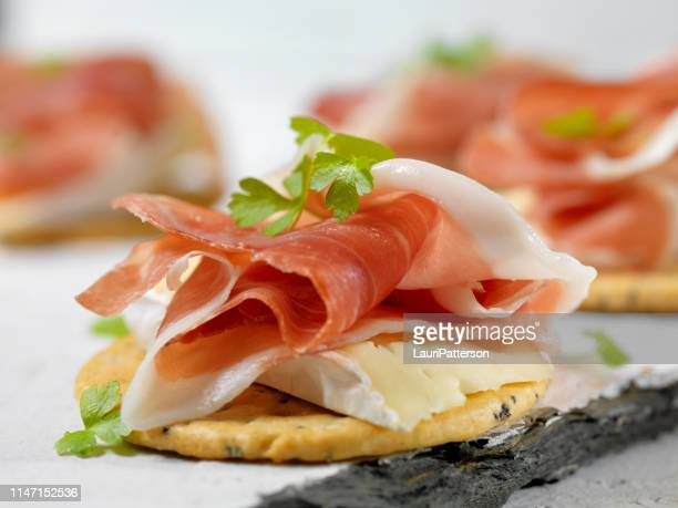 prosciutto and brie crackers - cracker snack stock photos and pictures