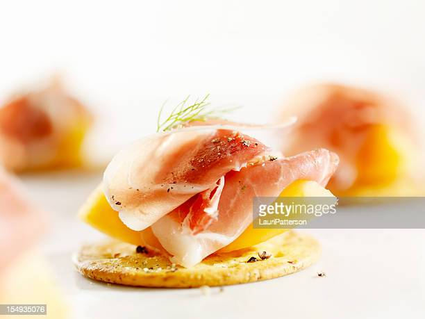 Canape stock photos and pictures getty images for Prosciutto and melon canape