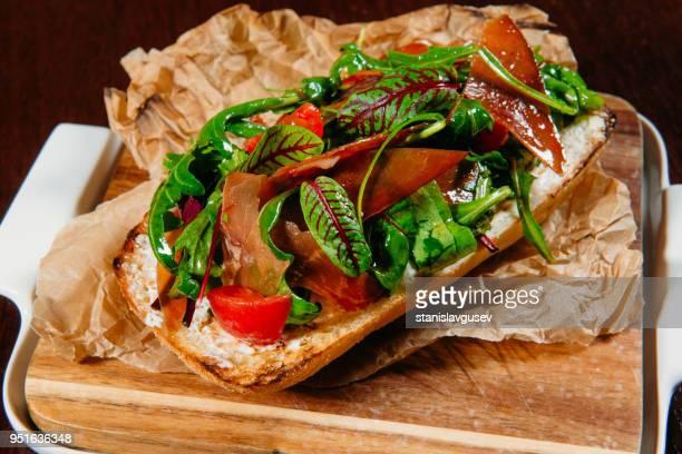 Prosciutto and salad ciabatta sandwich