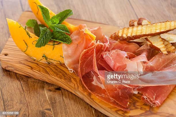 prosciutto di parma with melon slices
