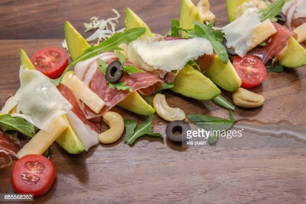 Prosciutto ham and avocado salad with Mozzarella and arugula