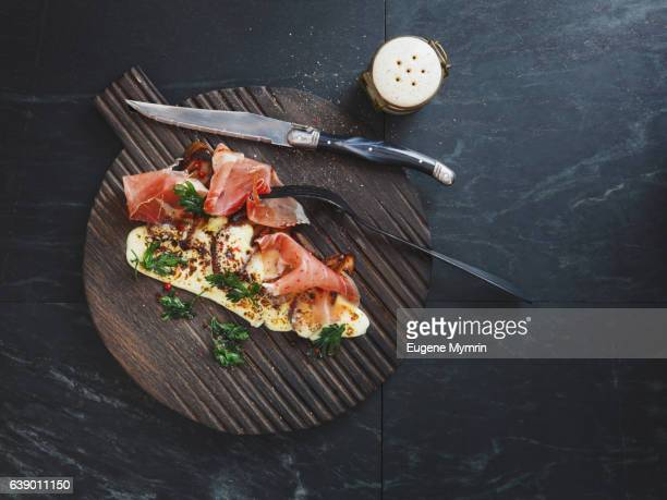 prosciutto with porcini, cheese and herb - prosciutto stock photos and pictures