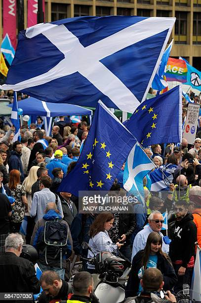 ProScottish Independence supporters with Scottish Saltire flags and EU flags rally in George Square in Glasgow Scotland on July 30 2016 to call for...