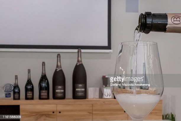 Prosecco is poured into the glass inside a cellar on July 12 2019 in Conegliano ItalyThe Conegliano and Valdobbiadene regions of northeast Italy have...