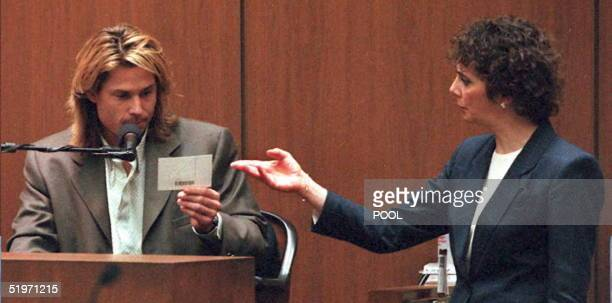 Prosector Marcia Clark shows OJ Simpson house guest Brian Kato Kaelin a picture of the the crime scene at the OJ Simpson estate 21 March 1995 during...
