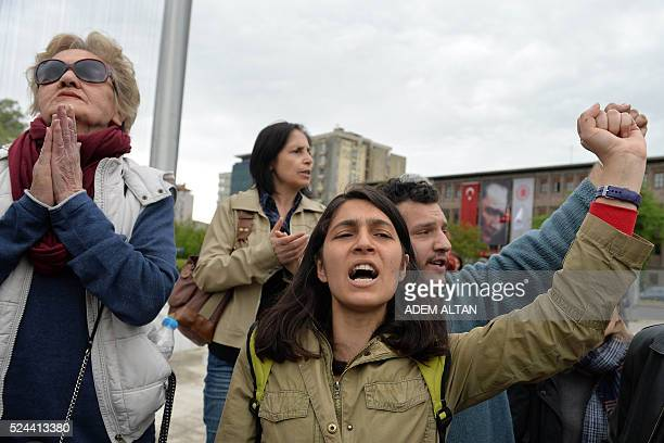 Prosecular Turks stage a protest outside the Parliament in Ankara on April 26 2016 Turkish police on April 26 fired tear gas to disperse...