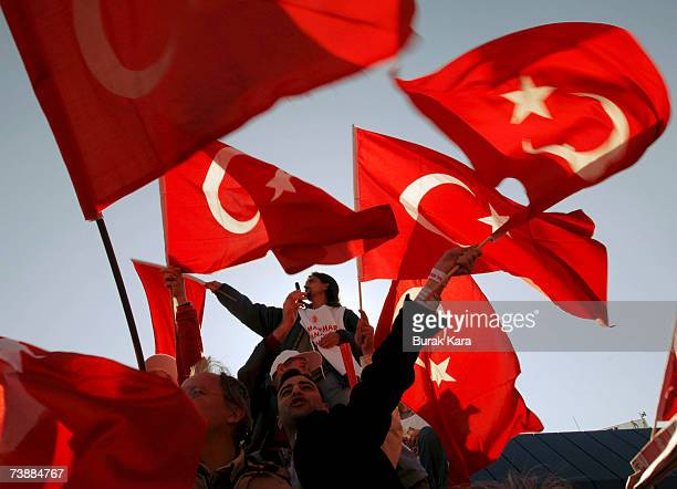 Prosecularist Turks holding their national flags attend a rally against Turkish Prime Minister Tayyip Erdogan's possible candidacy to the presidency...
